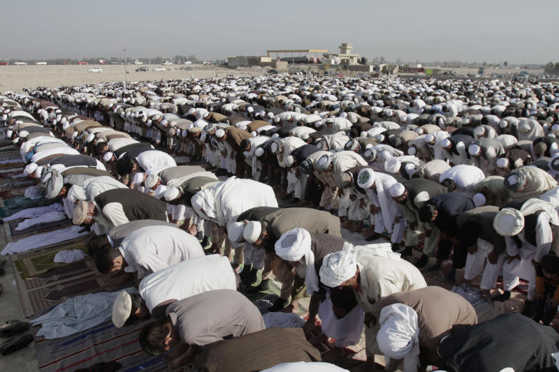 Afghans offer Eid al-Adha prayers outside a mosque in the outskirt of Jalalabad east of Kabul, Afghanistan, Friday, Oct. 26, 2012. Eid al-Adha is a religious festival celebrated by Muslims worldwide to commemorate the willingness of Prophet Ibrahim to sacrifice his son as an act of obedience to God. (AP Photo/Rahmat Gul)