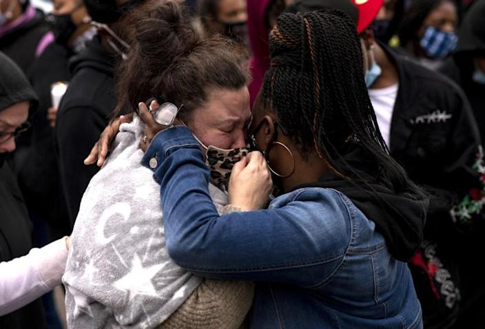 BROOKLYN CENTER, MN - APRIL 12: Katie Wright (L), the mother of Daunte Wright, is embraced during a vigil for her son on April 12, 2021 in Brooklyn Center, Minnesota. Wright was shot and killed yesterday by Brooklyn Center police during a traffic stop. (Photo by Stephen Maturen/Getty Images)