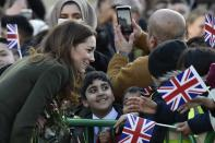 Britain's Kate Duchess of Cambridge speaks with a pupil as she meets the members of the public at Centenary Square in Bradford northern England, Wednesday, Jan. 15, 2020. (AP Photo/Rui Vieira)