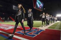 Models walk during rehearsals for the Tommy Hilfiger Fall/Winter 2015 collection presentation at the New York Fashion Week February 16, 2015. Shunning the traditional catwalk, Mr. Hilfiger instead presented his collection on a mock American Football field. REUTERS/Andrew Kelly (UNITED STATES - Tags: FASHION)