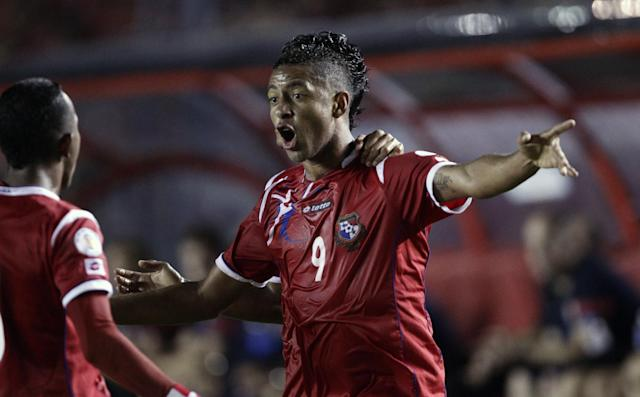 Panama's Gabriel Torres, center celebrates after scoring a goal against the U.S. during a 2014 World Cup qualifying soccer match in Panama City, Tuesday, Oct. 15, 2013. (AP Photo/Arnulfo Franco)