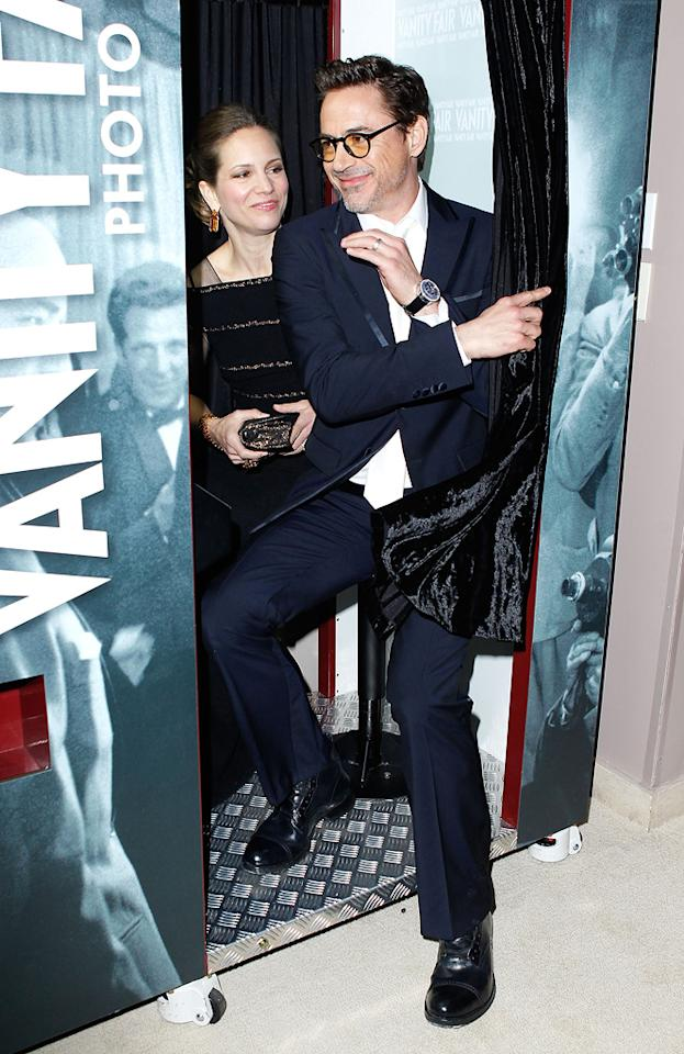 "Producer Susan Downey (""Unknown"") and hubby Robert Downey Jr. snuck into the photo booth at the packed Vanity Fair party."