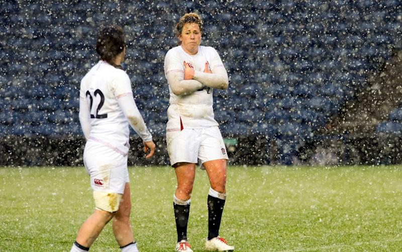 Katy Daley-Mclean and Amber Reed feel the cold as the weather keeps fans out of Murrayfield - PA