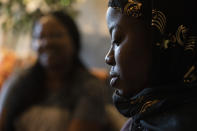 Fatumata Kromah, right, daughter of Rebecca Williams Sonyah, left, listens as her mother is interviewed at her home, Thursday, April 22, 2021, in Brooklyn Center. When protests began in a Minneapolis suburb after a white police officer fatally shot a Black man, 21-year-old Fatumata Kromah took to the street, pushing for change she says is essential to her Liberian immigrant community.(AP Photo/John Minchillo)