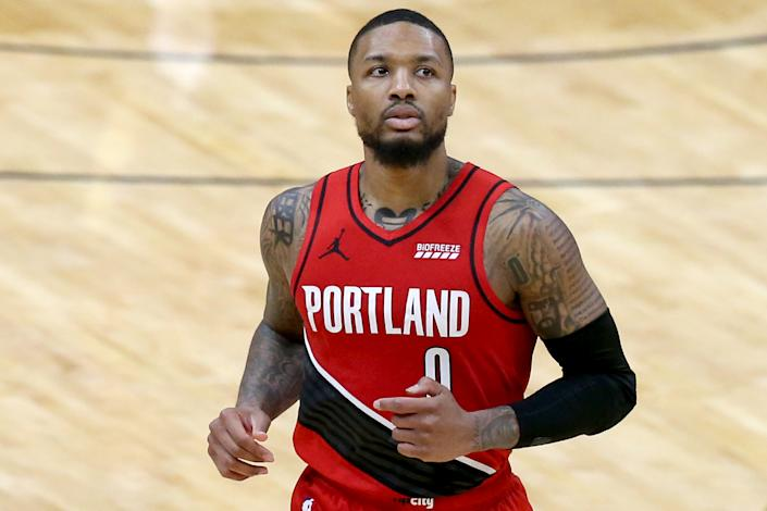 Damian Lillard #0 of the Portland Trail Blazers stands on the court during the fourth quarter of an NBA game against the New Orleans Pelicans.