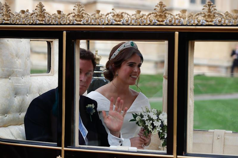 Princess Eugenie of York and her husband Jack Brooksbank at the start of their carriage procession.