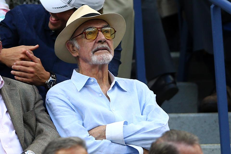 NEW YORK, NY - SEPTEMBER 11:  Actor Sean Connery attend the Men's Singles Semifinals match between Novak Djokovic of Serbia and Marin Cilic of Croatia on Day Twelve of the 2015 US Open at the USTA Billie Jean King National Tennis Center on September 11, 2015 in the Flushing neighborhood of the Queens borough of New York City.  (Photo by Clive Brunskill/Getty Images)