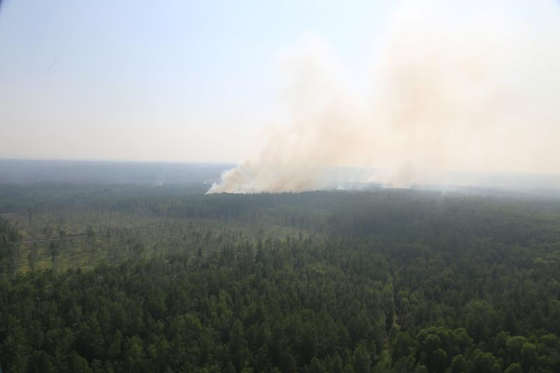 An aerial view through an aircraft window shows smoke from wildfires rising above the Boguchansky district of Krasnoyarsk Region, Russia in this handout picture obtained by Reuters on August 7, 2019. Russian Emergencies Ministry in Krasnoyarsk Region/Handout via REUTERS ATTENTION EDITORS - THIS IMAGE WAS PROVIDED BY A THIRD PARTY. NO RESALES. NO ARCHIVES. MANDATORY CREDIT.