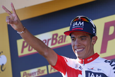 FILE PHOTO: Cycling - Tour de France cycling race - The 160-km (99,4 miles) Stage 15 from Bourg-en-Bresse to Culoz, France - 17/07/2016 - IAM team rider Jarlinson Pantano of Colombia reacts on the podium. REUTERS/Juan Medina/File Photo