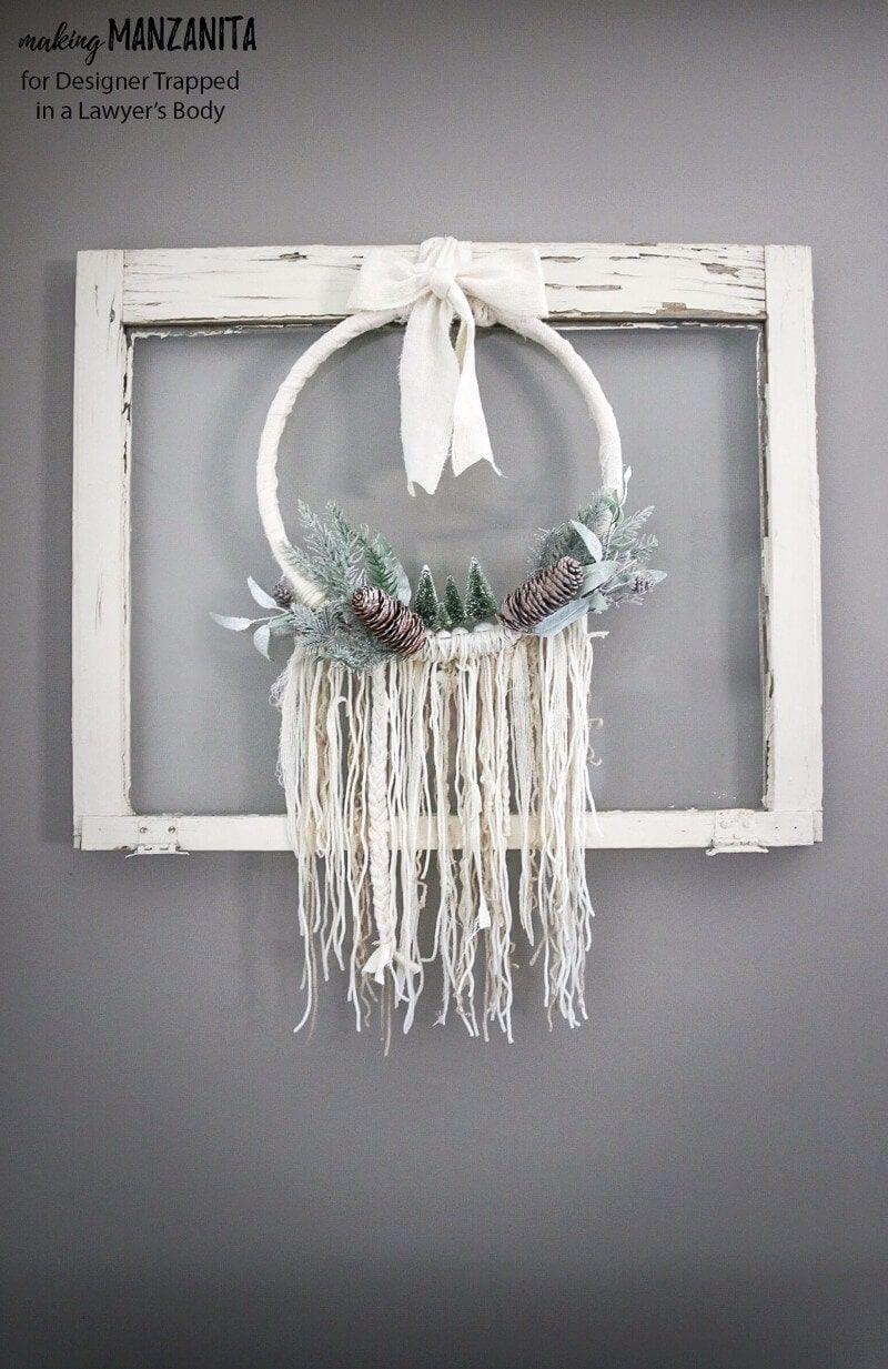 """<p>Break away from the traditional wreath by opting for this boho version. We love the mini seasonal touches like pinecones and <a href=""""https://www.countryliving.com/home-design/g2800/bottlebrush-trees-christmas-decorating-ideas/"""" rel=""""nofollow noopener"""" target=""""_blank"""" data-ylk=""""slk:bottlebrush trees"""" class=""""link rapid-noclick-resp"""">bottlebrush trees</a>.</p><p><strong>Get the tutorial at <a href=""""https://designertrapped.com/diy-winter-wreath-boho-style/"""" rel=""""nofollow noopener"""" target=""""_blank"""" data-ylk=""""slk:Kaleidoscope Living"""" class=""""link rapid-noclick-resp"""">Kaleidoscope Living</a>.</strong></p><p><strong><a class=""""link rapid-noclick-resp"""" href=""""https://www.amazon.com/KUUQA-Plastic-Ornaments-Tabletop-Decoration/dp/B077D43FZC/?tag=syn-yahoo-20&ascsubtag=%5Bartid%7C10050.g.23489557%5Bsrc%7Cyahoo-us"""" rel=""""nofollow noopener"""" target=""""_blank"""" data-ylk=""""slk:SHOP BOTTLE BRUSH TREES"""">SHOP BOTTLE BRUSH TREES</a><br></strong></p>"""
