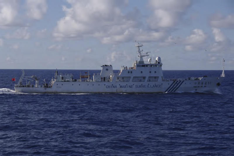 CORRECTS BEARING TO SOUTH-SOUTHWEST- In this photo released by Japan Coast Guard, the Chinese surveillance ship Haijian No. 51 cruises in waters about 24 kilometers (about 15 miles) south-southwest of disputed islands, called Senkaku in Japan and Diaoyu in China, in the East China Sea on Friday morning, Sept. 14, 2012. The Japanese government says six Chinese surveillance ships have entered Japanese waters near disputed islands in the East China Sea. It was the first intrusion by Chinese vessels into Japanese waters since Japan bought the islands from their private Japanese owners this week. (AP Photo/Japan Coast Guard)