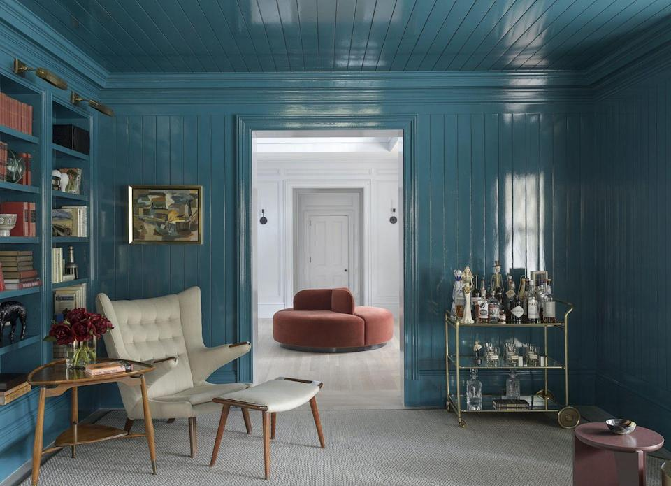 <p>The glossy shine of lacquered paint can make the room feel larger. It has a similar effect to a mirror, as the high-shine finish allows for highlights and reflection. Envelop the whole space in it from floor to ceiling for a glossy impact. </p>