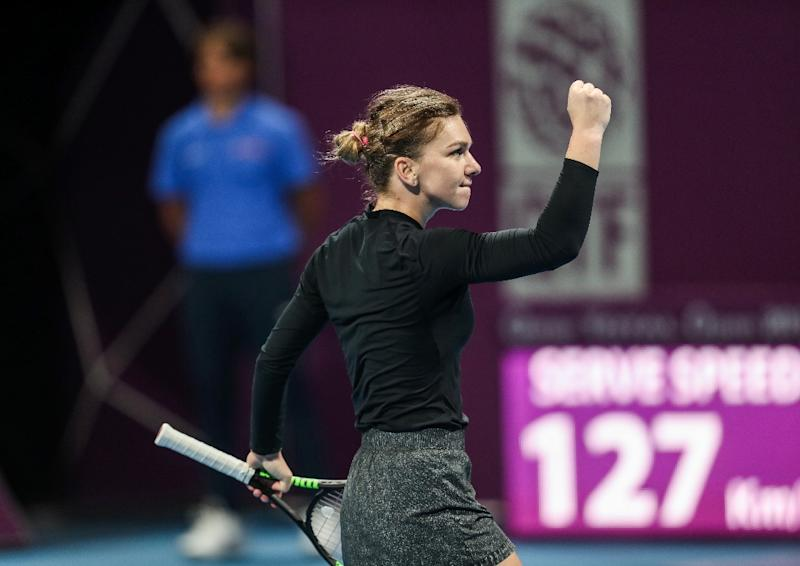 Mertens shrugs off back pain to beat Halep for Qatar Open title