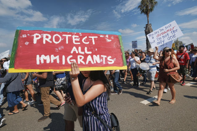 <p>Supporters of the Deferred Action for Childhood Arrivals, or DACA chant slogans and carry signs while joining a Labor Day rally in downtown Los Angeles, Monday, Sept. 4, 2017. (Photo: Richard Vogel/AP) </p>