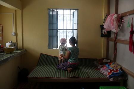 Nu Nu Aye, 22, with her child at an office of an NGO for abused women in Dawei
