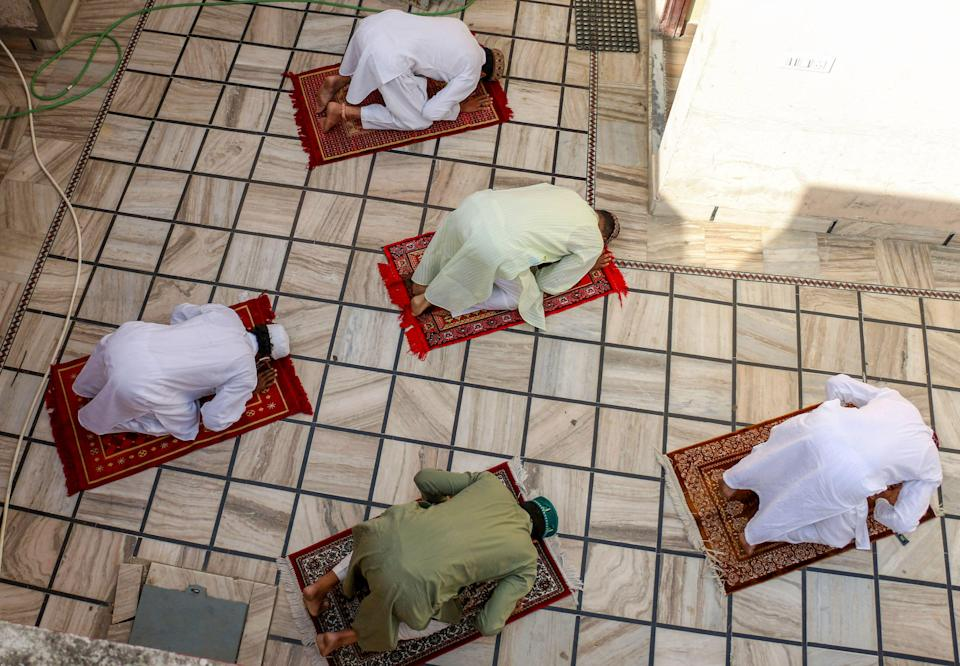 Muslim devotees offer prayers on the occasion of Eid-ul-Fitr, marking the end of holy fasting month of Ramadan, during the ongoing COVID-induced lockdown, at their residence in Ajmer, Friday, May 14, 2021.