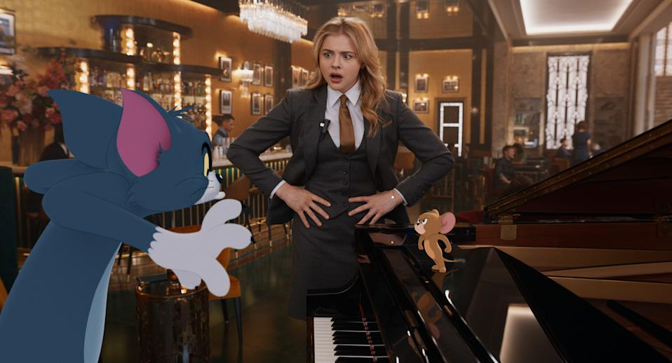 "(L-r) TOM, CHLOE GRACE MORETZ as Kayla and JERRY in Warner Bros. animated/live-action adventure ""TOM & JERRY,"" (Warner Bros. Pictures)"