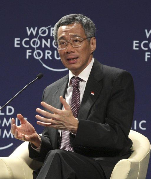 Singaporean Prime Minister Lee Hsien Loong gestures as he speaks during a session at the World Economic Forum On East Asia In Jakarta, Indonesia, Sunday, June 12, 2011. (AP Photo/Dita Alangkara)