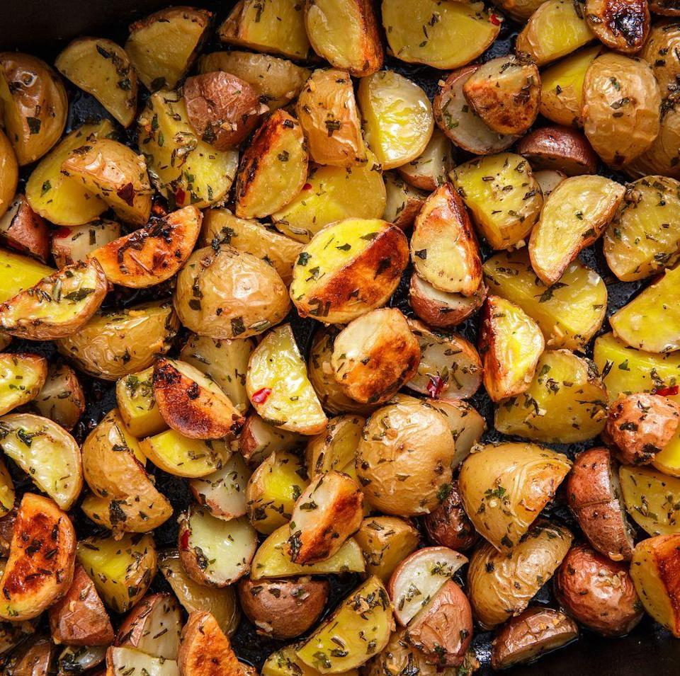 """<p>We're convinced of two things. First, this is the best roasted potato recipe out there and second, you should definitely make a batch tonight.</p><p>Get the <a href=""""https://www.delish.com/uk/cooking/recipes/a28786247/herb-roasted-potatoes/"""" rel=""""nofollow noopener"""" target=""""_blank"""" data-ylk=""""slk:Herb Roasted Potatoes"""" class=""""link rapid-noclick-resp"""">Herb Roasted Potatoes</a> recipe.</p>"""
