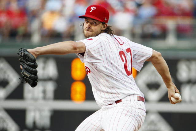 Philadelphia Phillies starting pitcher Aaron Nola throws during the first inning of the team's baseball game against the Chicago Cubs, Wednesday, Aug. 14, 2019, in Philadelphia. (AP Photo/Chris Szagola)