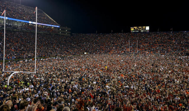 Auburn fans storm the field to celebrate the win over Alabama after the Iron Bowl, and they caused some seismic ground noise at the same time. (AP Photo)