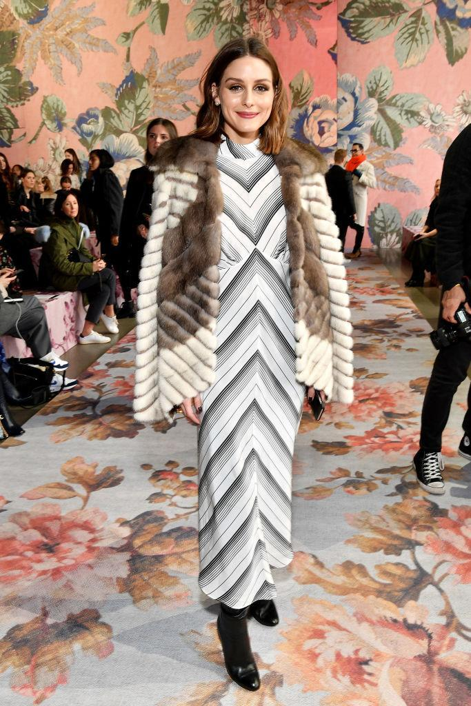 <p>FROW regular Olivia Palermo never fails to deliver on the sartorial front. This season, she rocked an ankle-skimming dress and coat (thrown over the shoulders a la blogger) coat at the Zimmermann show. <em>[Photo: Getty]</em> </p>
