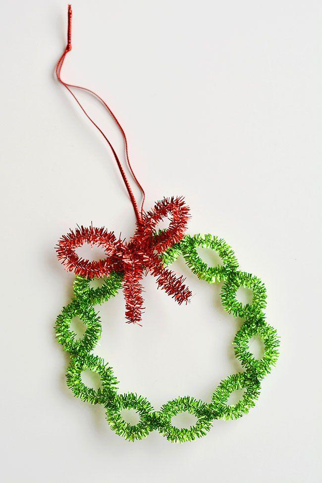 """<p>If you bend pipe cleaners just so, you'll end up with a sparkly wreath that'll shine on your tree. </p><p><em>Get the tutorial at <a href=""""https://onelittleproject.com/pipe-cleaner-wreath-ornaments/"""" rel=""""nofollow noopener"""" target=""""_blank"""" data-ylk=""""slk:One Little Project"""" class=""""link rapid-noclick-resp"""">One Little Project</a>.</em></p><p><a class=""""link rapid-noclick-resp"""" href=""""https://www.amazon.com/WILLBOND-Cleaners-Colorful-Chenille-Projects/dp/B07Z3R62C4?tag=syn-yahoo-20&ascsubtag=%5Bartid%7C10072.g.34443405%5Bsrc%7Cyahoo-us"""" rel=""""nofollow noopener"""" target=""""_blank"""" data-ylk=""""slk:SHOP GLITTER PIPE CLEANERS"""">SHOP GLITTER PIPE CLEANERS</a></p>"""