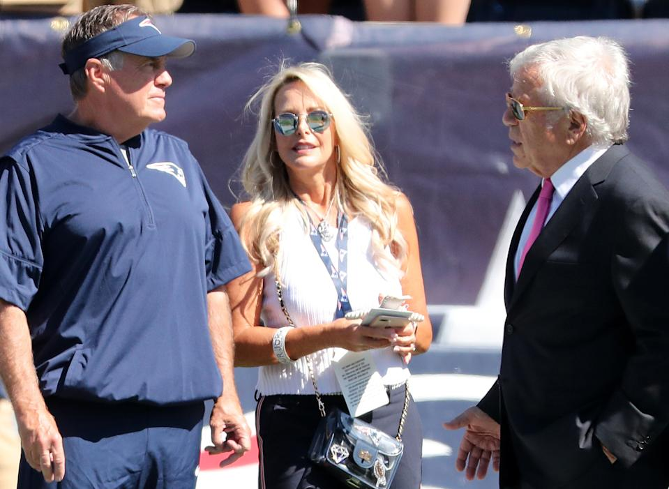 FOXBOROUGH, MA - SEPTEMBER 22: From left, New England Patriots head coach Bill Belichick, his girlfriend Linda Holliday and Patriots owner Robert Kraft stand on the field before the game. The New England Patriots host the New York Jets in a regular season NFL football game at Gillette Stadium in Foxborough, MA on Sep. 22, 2019. (Photo by Matthew J. Lee/The Boston Globe via Getty Images)