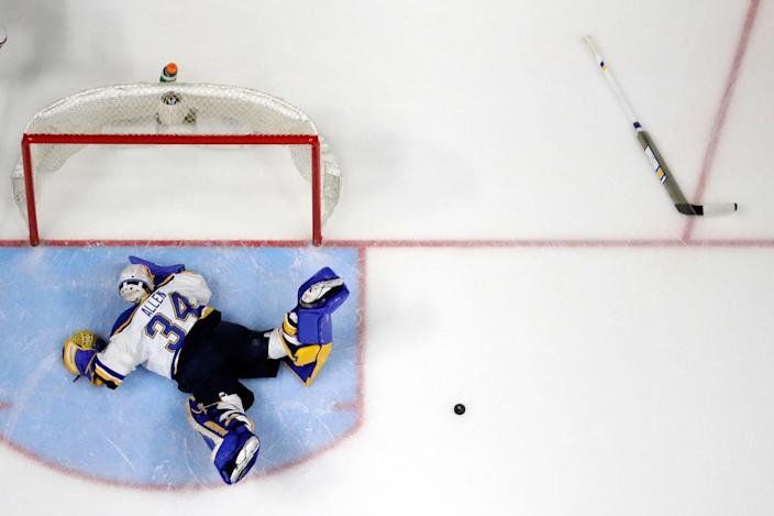 <p>St. Louis Blues goalie Jake Allen dives after the puck after losing his stick during the third period in Game 3 of a second-round NHL hockey playoff series against the Nashville Predators Monday, May 1, 2017, in Nashville, Tenn. (AP Photo/Mark Humphrey) </p>
