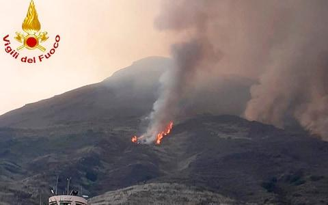 In this frame grab taken from footage provided by the Italian Firefighters, smoke billows from the volcano on the Italian island of Stromboli. - Credit: Italian fire service/AP