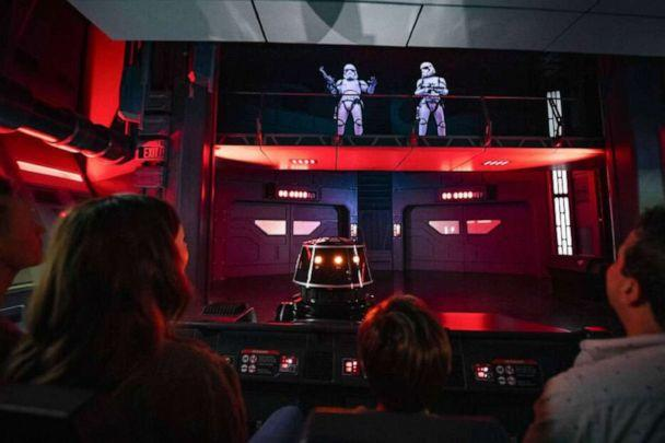 PHOTO: Guests flee First Order Stormtroopers onboard a Star Destroyer as part of Star Wars: Rise of the Resistance. (Matt Stroshane)