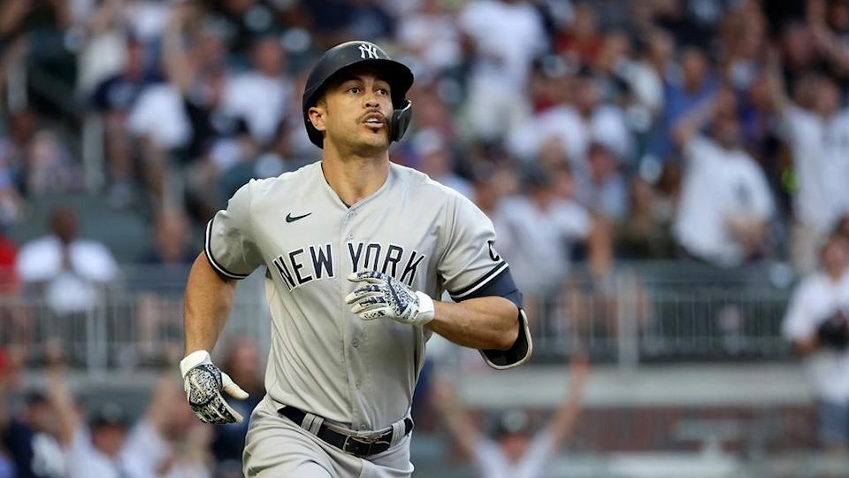 Yankees outfielder Giancarlo Stanton reacts after hitting a solo home run against the Atlanta Braves during the second inning in 2021