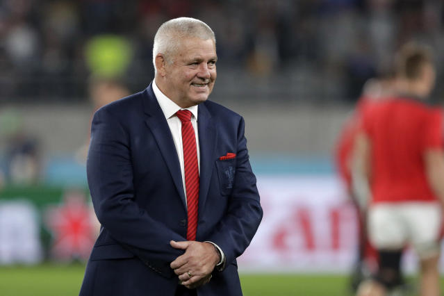Wales coach Warren Gatland, walks on the field prior to the Rugby World Cup bronze final game at Tokyo Stadium between New Zealand and Wales in Tokyo, Japan, Friday, Nov. 1, 2019. (AP Photo/Aaron Favila )