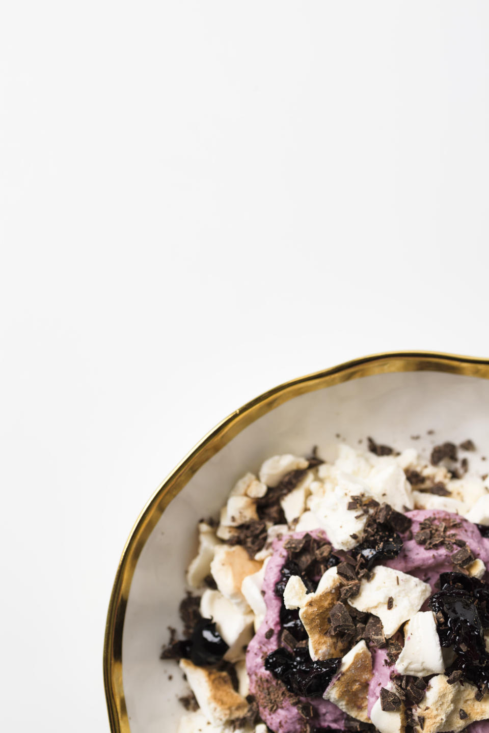 This image released by Milk Street shows a recipe for Eton Mess with Chocolate and Cherries. (Milk Street via AP)