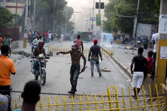 <p>Demonstrators protest over the cost of fuel in Port-au-Prince, Haiti, Friday, July 6, 2018. (Photo: Dieu Nalio Chery/AP) </p>