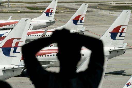 Malaysia Airlines plane turns back after 'bomb threat'