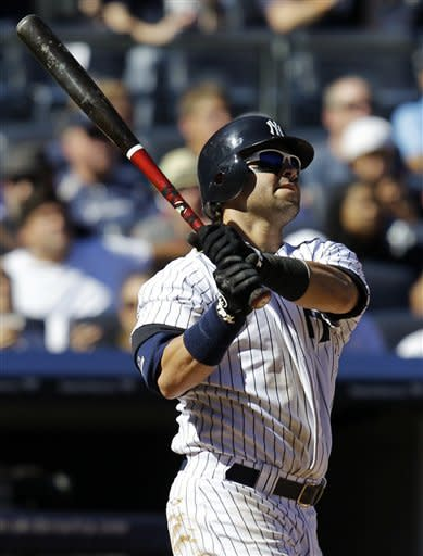 New York Yankees' Nick Swisher watches his fourth-inning, two-run home run off Oakland Athletics starting pitcher A.J. Griffin in their baseball game at Yankee Stadium in New York, Sunday, Sept. 23, 2012. (AP Photo/Kathy Willens)