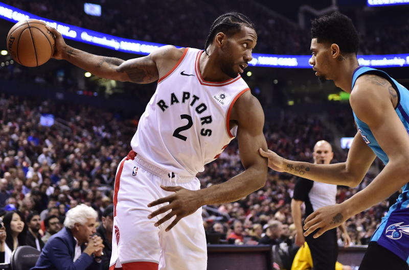 dc7de91e4f3 Toronto Raptors forward Kawhi Leonard (2) protects the ball from Charlotte  Hornets guard Jeremy Lamb during the first half of an NBA basketball game  Sunday