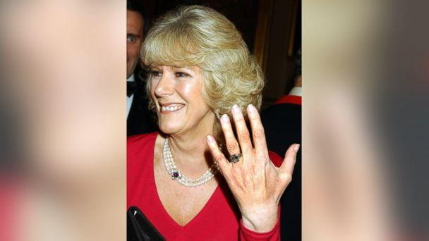 PHOTO: Camilla Parker Bowles shows off her engagement ring as she and Prince Charles arrive for a party at Windsor Castle after announcing their engagement earlier on Feb. 10, 2005. (John Stillwell/AFP/Getty Images)