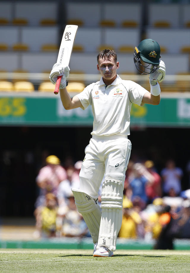 Australia's Marnus Labuschagne celebrates reaching his hundred during their cricket test match against Pakistan in Brisbane, Australia, Saturday, Nov. 23, 2019. (AP Photo/Tertius Pickard)