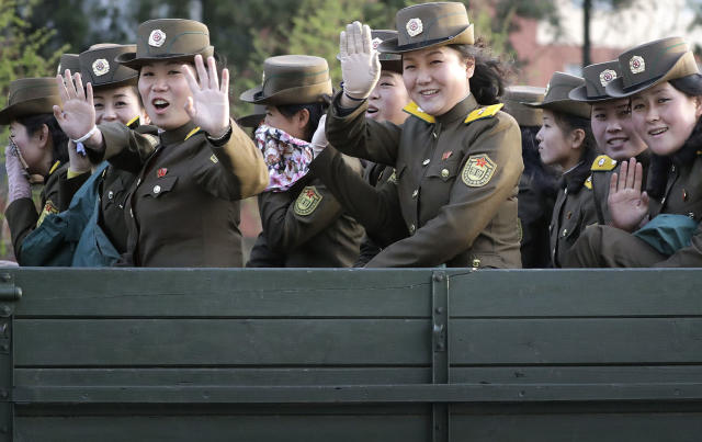<p>Female North Korean soldiers wave from the back of a truck at oncoming traffic on April 20, 2017, in Pyongyang, North Korea. (Photo: Wong Maye-E/AP) </p>