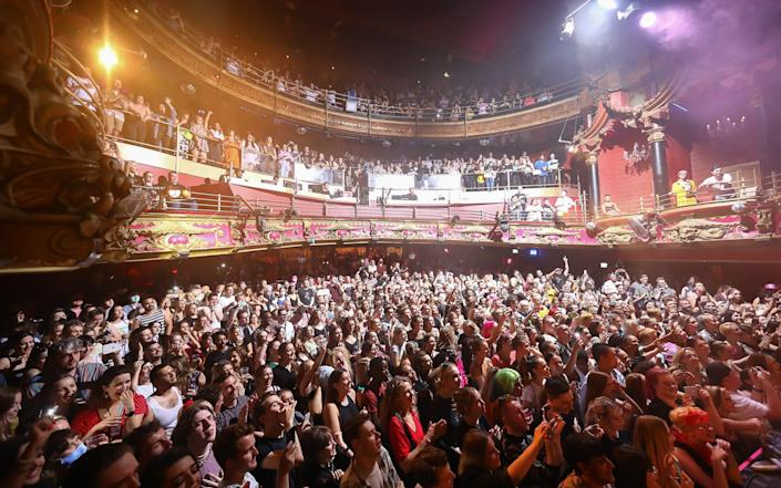 Revellers enjoy the show as The Clapham Grand welcomes audience members at full capacity - Tim P. Whitby/Getty Images