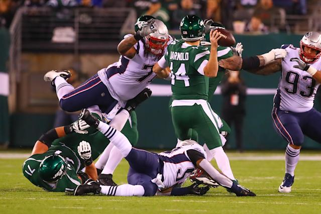 New England Patriots defensive tackle Danny Shelton (71) pressures New York Jets quarterback Sam Darnold (14) during the Patriots' win. (Getty Images)
