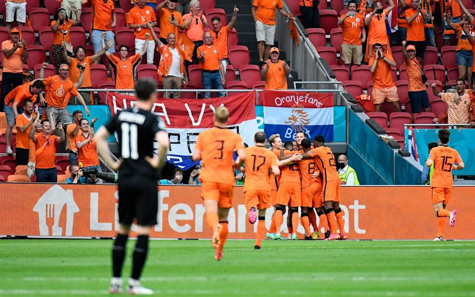 Depay celebrates with his teammates after scoring from the spot - GETTY IMAGES
