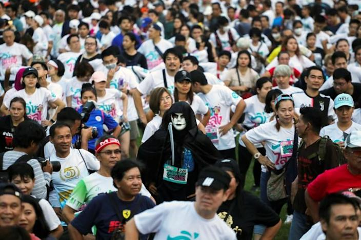 """A runner wearing a mask attends a """"Run Against Dictatorship"""" event at a public park in Bangkok"""