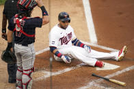 Minnesota Twins' Nelson Cruz has a hard landing after avoiding a close pitch from Cleveland Indians pitcher J.C. Mejia in the first inning of a baseball game, Thursday, June 24, 2021, in Minneapolis (AP Photo/Jim Mone)