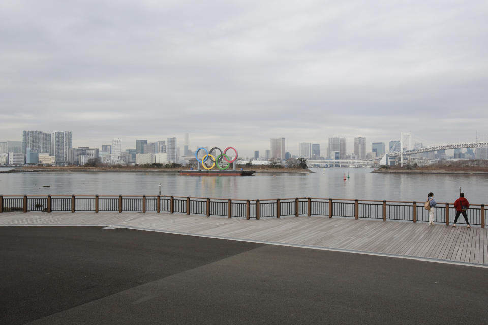 The Olympic rings are seen at the empty Odaiba waterfront in Tokyo, Tuesday, Jan. 26, 2021. The Tokyo Games, postponed in the midst of a pandemic, are scheduled to open on July 23. (AP Photo/Koji Sasahara)