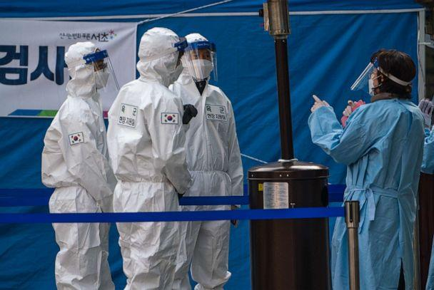PHOTO: Medical staff dressed in protective suits work at a temporary COVID-19 testing site in Gangnam Station, Seoul, Dec. 26, 2020. (Simon Shin/SOPA Images/LightRocket via Getty Images, FILE)