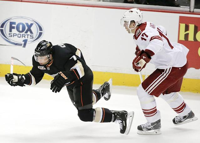 Phoenix Coyotes right wing Radim Vrbata, right, trips Anaheim Ducks' Andrew Cogliano during the second period of an NHL hockey game in Anaheim, Calif., Saturday, Dec. 28, 2013. (AP Photo/Chris Carlson)