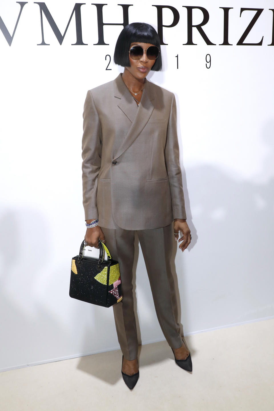 Channeling her inner Anna Wintour, Campbell rocked the blunt bob and oversized shades for the LVMH Prize 2019 Edition. The suit, a very different look for her, was a hit and we are especially in love with the boxed bag. [Getty Images]